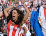A woman celebrates a goal of Paraguay ag