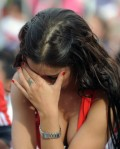 A Paraguayan woman reacts in dejection a